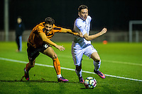 Friday  16 December 2014<br /> Pictured:  Brandon Ball Wolverhampton Wonderers  chases Liam Edwards of Swansea City <br /> Re: Swansea City U18s v Wolverhampton Wonderers U18s, 3rd Round FA youth Cup Match at the Landore Training Facility, Swansea, Wales, UK