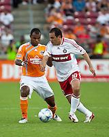 Chicago Fire midfielder Cuauhtemoc Blanco (10) attempts to dribble around Houston Dynamo defender Julius James (3).  Houston Dynamo defeated Chicago Fire 3-2  at Robertson Stadium in Houston, TX on August 9, 2009.