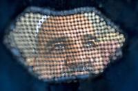 AFGHANISTAN, 06.2008, Kabul. Frauenblick: Ein Mann aus der Burka heraus gesehen. | Women's view: A man seen through the burqa.<br /> © Marzena Hmielewicz/EST&OST