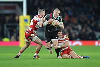 Mike Brown of Harlequins looks to get through Jonny May and James Hook of Gloucester Rugby during the Aviva Premiership Rugby match between Harlequins and Gloucester Rugby at Twickenham Stadium on Tuesday 27th December 2016 (Photo by Rob Munro/Stewart Communications)