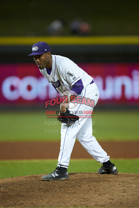 Winston-Salem Dash relief pitcher Jose Nin (32) looks to his catcher for the sign against the Carolina Mudcats at BB&T Ballpark on June 1, 2019 in Winston-Salem, North Carolina. The Dash defeated the Mudcats 5-4 in game two of a double header. (Brian Westerholt/Four Seam Images)