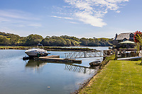 BNPS.co.uk (01202 558833)<br /> Pic: Savills/BNPS<br /> <br /> Pictured: The pontoon on Mill Pond.<br /> <br /> A former tidal mill next to an impressive viaduct that looks like the perfect backdrop for a children's book is on the market for £3.5m.<br /> <br /> The Old Mill is over 600 years old and would be an ideal home for Swallows and Amazons or The Railway Children-inspired adventures.<br /> <br /> The impressive Grade II listed six-bedroom house has its own private harbour and panoramic views of the much-photographed Forder Railway Viaduct.<br /> <br /> It is only the second time the property in Cornwall has been on the market since 1886 and agents Savills say it is a once in a lifetime opportunity.