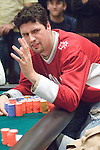 "Brad ""Yukon"" Booth tries to make a read ofthe hand taking place."