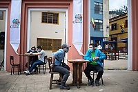 "BOGOTA - COLOMBIA, 05-09-2020: Comensales esperan durante el primer día del piloto de apertura de restaurantes y cafés al aire libre, denominado ""Bogotá a Cielo Abierto"", en el Chorro de Quevedo en el centro de Bogotá que ahora tiene sus calles pintadas con formas geométricas en pintura neón y cuenta con mesas, distribuidas estratégicamente para mantener el distanciamiento físico al finalizar la cuarentena total en el territorio colombiano causada por la pandemia  del Coronavirus, COVID-19. / Dinners await during the first day of the pilot for the opening of restaurants and outdoor cafes, called ""Bogotá a Cielo Abierto"", in Chorro de Quevedo in the center of Bogotá, which now has its streets painted with geometric shapes in neon paint and has tables, strategically distributed to maintain physical distancing at the end of the total quarantine in the Colombian territory caused by the Coronavirus pandemic, COVID-19. Photo: VizzorImage / Johan Rugeles / Cont"