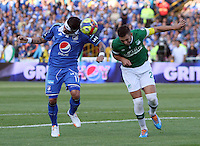 BOGOTA -COLOMBIA. 05-04-2014. Dayro Moreno  (Izq) de Millonarios  disputa el balon contra Luis Calderon del Deportivo Cali partido por la  quinceava  fecha de La liga Postobon 1 disputado en el estadio Nemesio Camacho El Campin. /  Dayro Moreno (L)  of Millonarios   fights the ball against Luis Calderon  of Deportivo Cali   during the match for the fifteenth round of The Postobon one league match at Nemesio Camacho El Campin  Stadium . Photo: VizzorImage/ Felipe Caicedo / Staff