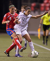 Carli Lloyd, right, of the United States and Carol Sanchez of Costa Rica battle for the ball during play in the CONCACAF Olympic Qualifying semifinal match at BC Place in Vancouver, B.C., Canada Friday Jan. 27, 2012. The United States won the match 3-0 to earn a berth in 2012 London Olympics.