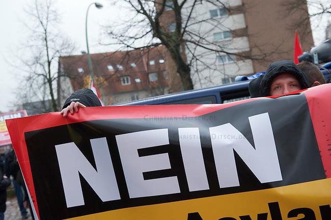 """Etwa 50 Anhaenger der NPD aus Berlin und Brandenburg demonstrierten am Samstag den 24. November 2012 im Berliner Bezirk Rudow gegen eine Unterkunft fuer Asylsuchende. Mehere hundert Antifaschisten gelang es die Demonstrationsroute zu blockieren, so dass die Demonstration der Neonazis, unter ihnen viele aus dem sog. """"Nationalen Widerstand"""" abgebrochen werden musste.<br /> 24.11.2012, Berlin<br /> Copyright: Christian-Ditsch.de<br /> [Inhaltsveraendernde Manipulation des Fotos nur nach ausdruecklicher Genehmigung des Fotografen. Vereinbarungen ueber Abtretung von Persoenlichkeitsrechten/Model Release der abgebildeten Person/Personen liegen nicht vor. NO MODEL RELEASE! Nur fuer Redaktionelle Zwecke. Don't publish without copyright Christian-Ditsch.de, Veroeffentlichung nur mit Fotografennennung, sowie gegen Honorar, MwSt. und Beleg. Konto: I N G - D i B a, IBAN DE58500105175400192269, BIC INGDDEFFXXX, Kontakt: post@christian-ditsch.de<br /> Bei der Bearbeitung der Dateiinformationen darf die Urheberkennzeichnung in den EXIF- und  IPTC-Daten nicht entfernt werden, diese sind in digitalen Medien nach §95c UrhG rechtlich geschuetzt. Der Urhebervermerk wird gemaess §13 UrhG verlangt.]"""