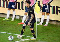 LOS ANGELES, CA - SEPTEMBER 23: Brian Rodriguez #17 of the Los Angeles football club takes a corner kick during a game between Vancouver Whitecaps and Los Angeles FC at Banc of California Stadium on September 23, 2020 in Los Angeles, California.
