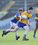 Mark Mc Inerney of  Clare  in action against Johnny Ryan of  Tipperary during their Munster Minor football semi-final at Thurles. Photograph by John Kelly.
