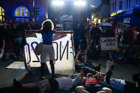 GERMANY, Hamburg, protest rally on Reeperbahn in St. Pauli against G-20 summit in july 2017, sitting protester in front of police water cannon / DEUTSCHLAND, Hamburg, St. Pauli, Protest Demo auf der Reeperbahn gegen G20 Gipfel in Hamburg, Sitzblockade vor Wasserwerfern an der Polizeistation Davidwache