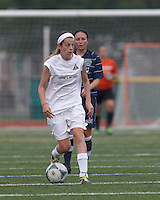 Boston Aztec defender Kerri Zerfoss (28) brings the ball forward.  In a Women's Premier Soccer League (WPSL) match, Boston Aztec (white) defeated Seacoast United Phantoms (blue), 3-0, at North Reading High School Stadium on Arthur J. Kenney Athletic Field on on June 25, 2013.