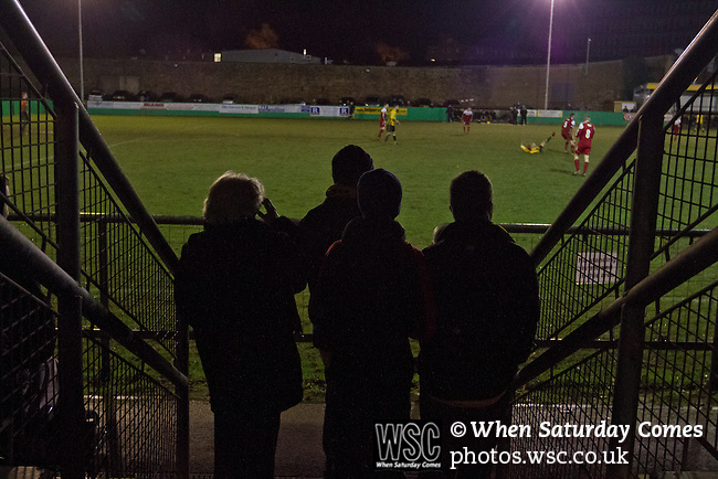 Belper Town v Gresley, 28/01/2014. Christchurch meadow, Northern Premier League. Home team supporters watching the action during the second-half of Belper Town's match against Gresley (in red), in a Northern Premier League, first division south fixture at Christchurch meadow. The home side have played at their current ground since the club was reformed in 1951. Belper won this fixture against their local Derbyshire rivals by 4 goals to 1 watched by a crowd of 165 spectators. Photo by Colin McPherson.