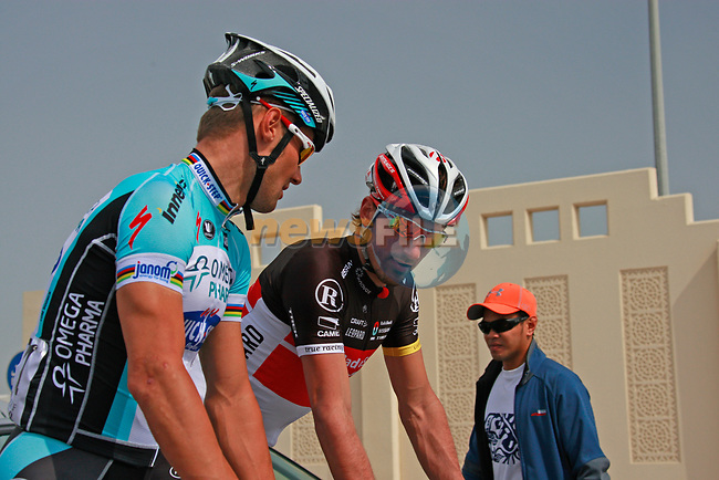 Tom Boonen (BEL) Omega Pharma-Quick Step chats with Fabian Cancellara (SUI) Radioshack-Nissan Trek before before the start of Stage 1 of the Tour of Qatar 2012 running 142.5km from Barzan Towers to Doha Golf Club, Doha, Qatar. 5th February 2012.<br /> (Photo by Eoin Clarke/NEWSFILE).