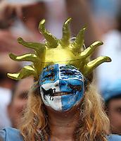 A Uruguay fan cheers her side on