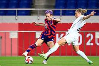 SAITAMA, JAPAN - JULY 24: Megan Rapinoe #15 of the United States turns on the ball during a game between New Zealand and USWNT at Saitama Stadium on July 24, 2021 in Saitama, Japan.