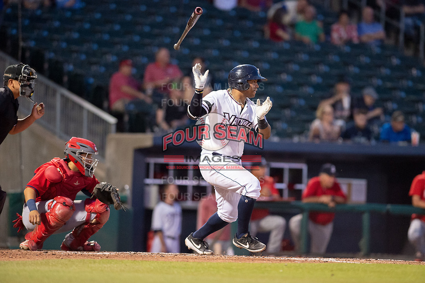 Northwest Arkansas Naturals catcher Meibrys Viloria (22) connects on a pitch on May 16, 2019, at Arvest Ballpark in Springdale, Arkansas. (Jason Ivester/Four Seam Images)