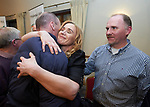 A defeated Rita Mc Inerney is hugged by her brother Francis watched by her boyfriend Mark Moran at the Fianna Fail selection convention in Hotel Woodstock. Photograph by John Kelly.