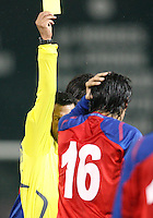 Referee Benito Archundia gives a yellow card to Cristian Montero #16 of Costa Rica during a 2010 World Cup qualifying match in the CONCACAF region at RFK Stadium on October 14 2009, in Washington D.C.The match ended in a 2-2 tie.
