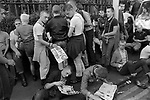 Skinheads London 1980s UK. A group of National Front young male supporters. Wear short jeans and braces, fashionable at the time. The poster leaflet being handed out reads 'Defend Our Rights, Join the National Front March through Fulham (London) Sunday August 30th 1981