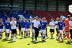 St Johnstone v Fleetwood Town…24.07.21  McDiarmid Park<br />Callum Booth holding the Scottish Cup and Michael O'Halloran holding the Betfred Cup lead their team mates on a lap of honour at McDiarmid Park showing the fans the two trophies<br />Picture by Graeme Hart.<br />Copyright Perthshire Picture Agency<br />Tel: 01738 623350  Mobile: 07990 594431