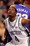 Connecticut forward Jeff Adrien (4) waits for a rebound.  Connecticut defeated Kentucky 87-83 in the second round of the NCAA Tournament  at the Wachovia Center in Philadelphia, Pennsylvania on March 19, 2006.