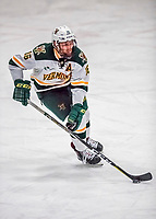 19 January 2018: University of Vermont Catamount Forward Derek Lodermeier, a Sophomore from Brooklyn Center, MN, controls the play up ice during the third period against the University of Massachusetts Lowell Riverhawks at Gutterson Fieldhouse in Burlington, Vermont. The Riverhawks rallied to defeat the Catamounts 3-2 in overtime of their Hockey East matchup. Mandatory Credit: Ed Wolfstein Photo *** RAW (NEF) Image File Available ***