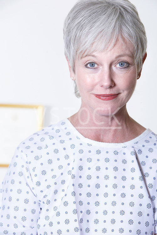 USA, California, Fairfax, Portrait of woman in hospital gown sitting in doctor's office