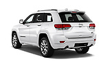 Car pictures of rear three quarter view of a 2017 Jeep Grand Cherokee Overland 5 Door SUV angular rear