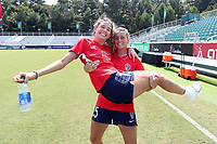 CARY, NC - SEPTEMBER 12: Meredith Speck #25 holds teammate Ryan Williams #13 of the North Carolina Courage before a game between Portland Thorns FC and North Carolina Courage at Sahlen's Stadium at WakeMed Soccer Park on September 12, 2021 in Cary, North Carolina.