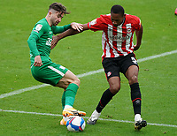 Preston North End's Sean Maguire shields the ball from Brentford's Ethan Pinnock<br /> <br /> Photographer Stephanie Meek/CameraSport<br /> <br /> The EFL Sky Bet Championship - Brentford v Preston North End - Sunday 4th October 2020 - Griffin Park - Brentford<br /> <br /> World Copyright © 2020 CameraSport. All rights reserved. 43 Linden Ave. Countesthorpe. Leicester. England. LE8 5PG - Tel: +44 (0) 116 277 4147 - admin@camerasport.com - www.camerasport.com