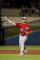 Washington Nationals shortstop Jackson Cluff (72) throws to first base during a Major League Spring Training game against the Houston Astros on March 19, 2021 at The Ballpark of the Palm Beaches in Palm Beach, Florida.  (Mike Janes/Four Seam Images)