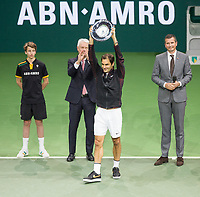 Rotterdam, The Netherlands, 18 Februari, 2018, ABNAMRO World Tennis Tournament, Ahoy, Singles final, Winner Roger Federer (SUI) with the trophy, right tournament director Richard Krajicek and left the CEO of the ABNAMRO Bank Kees van Dijkhuizen<br />