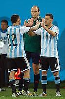 Ezequiel Lavezzi of Argentina is replaced bu Maxi Rodriguez