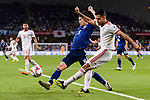 Morteza Pouraliganji of Iran (R) fights for the ball with Minamino Takumi of Japan (C) during the AFC Asian Cup UAE 2019 Semi Finals match between I.R. Iran (IRN) and Japan (JPN) at Hazza Bin Zayed Stadium  on 28 January 2019 in Al Alin, United Arab Emirates. Photo by Marcio Rodrigo Machado / Power Sport Images