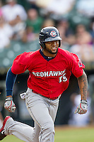 Oklahoma City RedHawks outfielder Domingo Santana (15) hustles down the first base line during the Pacific Coast League baseball game against the Round Rock Express on August 1, 2014 at the Dell Diamond in Round Rock, Texas. The Express defeated the RedHawks 6-5. (Andrew Woolley/Four Seam Images)