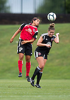 Jerica DeWolfe (20) of the D.C. United Women goes up for a header with Yasmin Bunter (17) of the Virginia Beach Piranhas during the game at the Maryland SoccerPlex in Boyds, Maryland.  The D.C. United Women defeated the Virginia Beach Piranhas, 3-0, to advance to the W-League Eastern Conference Championship.