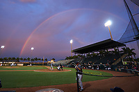 General view of a rainbow over the field during the second game of a doubleheader between the Tampa Yankees and Bradenton Marauders on June 14, 2017 at LECOM Park in Bradenton, Florida.  Pitcher Brandon Cumpton, catcher John Bormann, batter Nick Solak, umpire Derek Thomas, on deck batter Gosuke Katoh.  Tampa defeated Bradenton 5-1.  (Mike Janes/Four Seam Images)