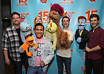 "Nick Kohn,  Jamie Glickman, Jason Jacoby and Matt Dengler with Avenue Q & Puppetry Fans during ""Avenue Q"" Celebrates World Puppetry Day at The New World Stages on 3/21/2019 in New York City."