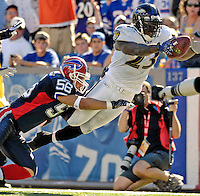 21 October 2007: Baltimore Ravens running back Willis McGahee dives into the end zone, capping his 46 yard rushing play for a Ravens touchdown in the third quarter against the Buffalo Bills at Ralph Wilson Stadium in Orchard Park, NY. The Bills defeated the Ravens 19-14 in front of 70,727 fans for their second win of the 2007 season. The visit to Buffalo marked McGahee's first game against his former teammates...Mandatory Photo Credit: Ed Wolfstein Photo
