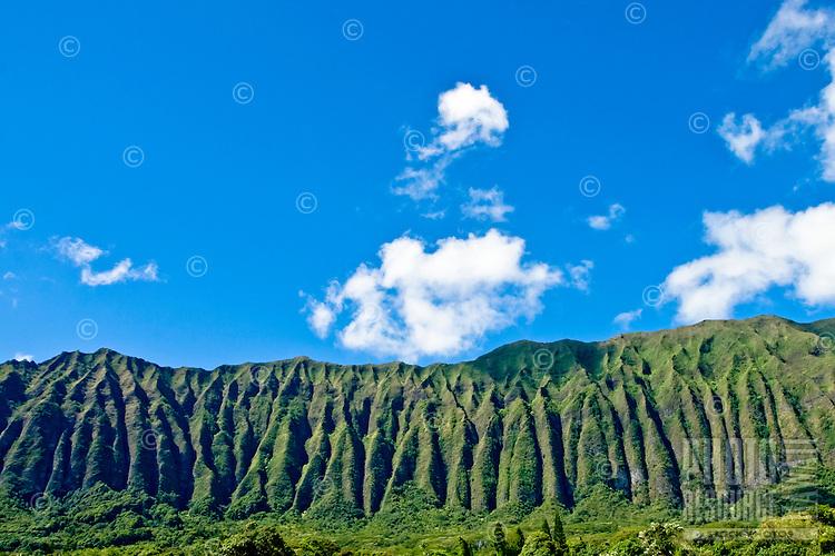 Panoramic Koolau Mountains against bright blue sky