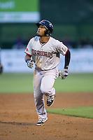 Andy Ibanez (7) of the Hickory Crawdads watches the flight of the baseball as he heads towards third base against the Kannapolis Intimidators at Kannapolis Intimidators Stadium on April 8, 2016 in Kannapolis, North Carolina.  The Crawdads defeated the Intimidators 8-2.  (Brian Westerholt/Four Seam Images)