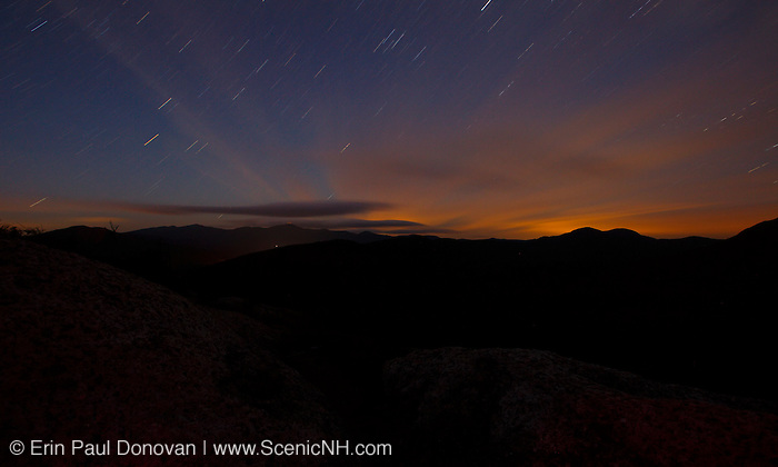 Silhouette of the Presidential Range at night from Middle Sugarloaf Mountain in Bethlehem, New Hampshire during the summer months.