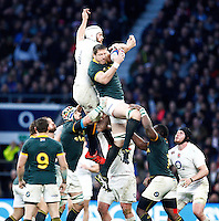 Photo: Richard Lane/Richard Lane Photography. England v South Africa. QBE Autumn International. 15/11/2014. South Africa's Bakkies Botha is challenged by England's Dave Attwood.