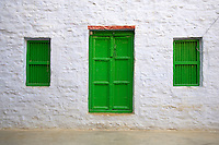 "The Green windows and door Jaisalmer the old City and fort.J a i s a l m e r   J a i s a l m e r  n i c k n a m e d   "" T h e   G o l d e n   C i t y "" ,   i s   a   t o w n   i n   t h e   I n d i a n   s t a t e   o f   R a j a s t h a n .   T h e   t o w n   s t a n d s   o n   a   r i d g e   o f   y e l l o w i s h   s a n d s t o n e ,   c r o w n e d   b y   a   f o r t ,   w h i c h   c o n t a i n s   t h e   p a l a c e   a n d   s e v e r a l   o r n a t e   J a i n   t e m p l e s .   M a n y   o f   t h e   h o u s e s   a n d   t e m p l e s   a r e   f i n e l y   s c u l p t u r e d .   I t   l i e s   i n   t h e   h e a r t   o f   t h e   T h a r   D e s e r t   a n d   h a s   a   p o p u l a t i o n   o f   a b o u t   7 8 , 0 0 0 .   I t   i s   t h e   a d m i n i s t r a t i v e   h e a d q u a r t e r s   o f   J a i s a l m e r   D i s t r i c t ....Jaisalmer Fort is one of the largest of desert forts of the world. It is situated in Jaisalmer city in Indian state of Rajasthan. It was built in 1156 AD by the Bhati Rajput ruler Rawal Jaisal, from where it derives it name. The fort stands proudly admist the golden stretches of the great Thar Desert, on Trikuta Hill and had been the scene of many battles. Its massive yellow sandstone walls are a tawny lion color during the day, turning to a magical honey-gold as the sun sets and camouflages the fort making it appear a part of the picturesque yellow desert. Thus, it is also known as the ""Golden Fort"".."