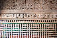 Berber Mocarabe Honeycomb work plaster decorations and Berber design tiles of the 17th century Berber Pavillion of the Ambassadors built Sultan Moulay Ismail.   A UNESCO World Heritage Site .Meknes, Meknes-Tafilalet, Morocco.