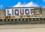 Close-up of old liquor sign on rundown building, Asbury Park, New Jersey
