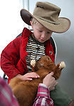 Jaxon Hardt, 4, pets a satin rabbit during the annual Farm Days event at Fuji Park in Carson City, Nev., on Thursday, April 17, 2014.<br /> Photo by Cathleen Allison