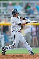 Bristol second baseman Oney Guillen (14) swings and misses versus Burlington at Burlington Athletic Park in Burlington, NC, Thursday, July 12, 2007.