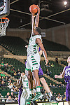 North Texas Mean Green guard Jordan Williams (23) in action during the game between the Stephen F. Austin Lumberjacks and the North Texas Mean Green at the Super Pit arena in Denton, Texas. SFA defeats UNT 87 to 53.
