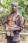 Man With Ingrediants For Making Drinks